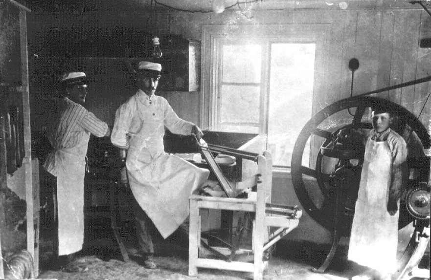 Oskar Lithell and his manual meat mincer in Kumla, Sweden.