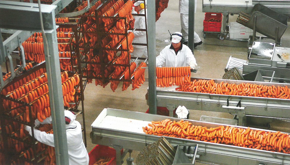 Atria's food factory produced large amounts of sausage despite the severe recession that gripped the country in the 1990s.